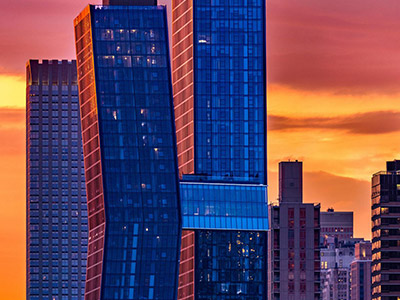 American Copper Buildings on the skyline at sunset.